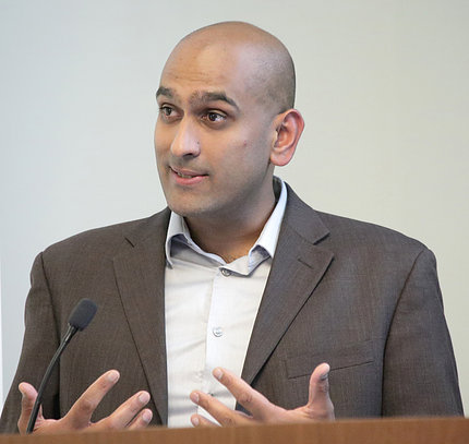Sandeep Patel speaks at podium