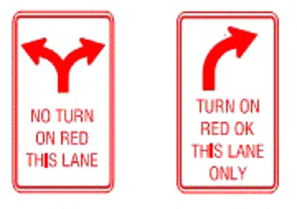 Two street signs, one with Y-shaped arrows and one with right-turn arrow