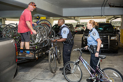 Officers load bikes onto truck.