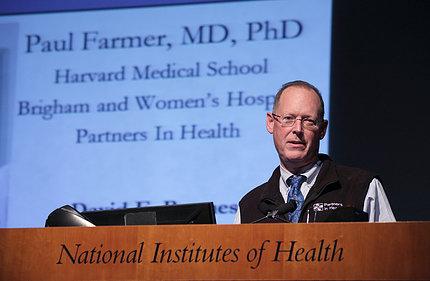 Dr. Farmer speaks at podium.