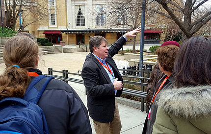 Schelp leads a tour historic Carolina Theater