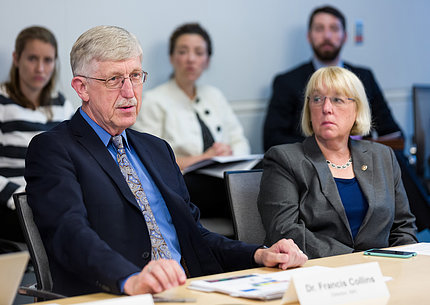 Collins and Sen. Patty Murray sit at a board table