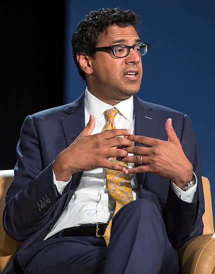 Dr. Atul Gawande interlaces fingers as he speaks