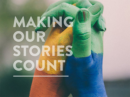 Two clasped hands painted in multiple colors with Making Our Stories Count printed on top