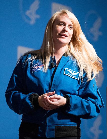 Dr. Rubins, wearing her blue NASA uniform