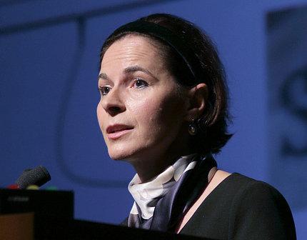 Dr. Yasmine Belkaid at podium