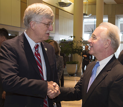 Collins shakes Price's hand