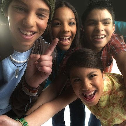 Four teens smile
