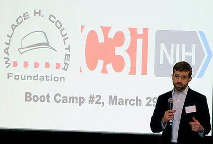 Merchak speaks in front of an audience