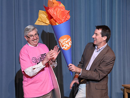 Koroshetz passes this year's CFC Olympic torch to Dr. Christopher Austin.