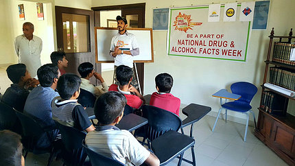 Teens in a Pakistani classroom learn dangers of addiction