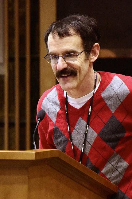 Resnik speaks at a podium