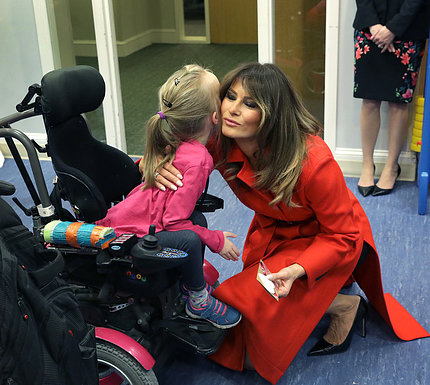 """The first lady embraces Alexis """"Lexi"""" Bingham."""
