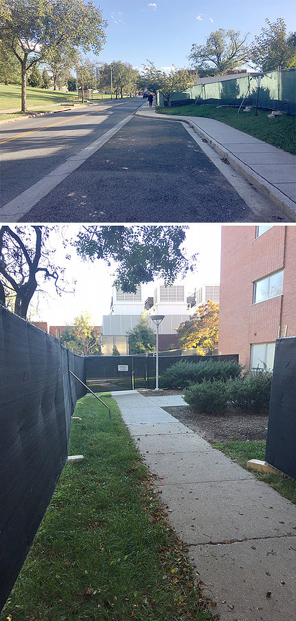 Sidewalk with construction fences alongside Bldg. 12A