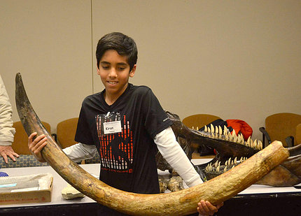 AIS student Kiran Nadanam gets the feel of a real mammoth tusk.