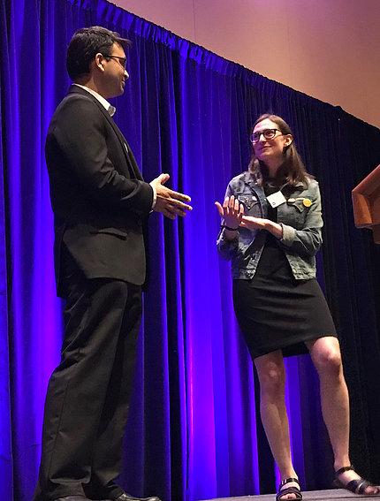 Dr. Sarthak Gupta does a practice interview with Sarah Kaplan onstage.