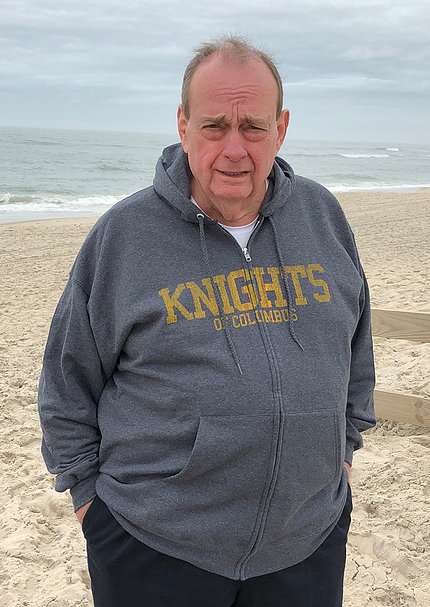 Dr. Fred Taylor standing on the beach.