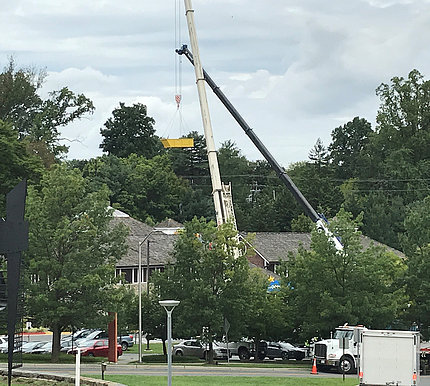 Cranes were used to remove construction materials from the damaged roof.