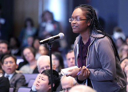 An attendee asks a question at the summit