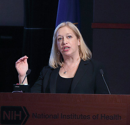Dr. Schneider presents at a podium