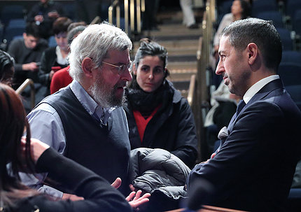 Galea speaks with a bearded man after his talk