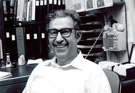 Dr. Rosen smiles in his office