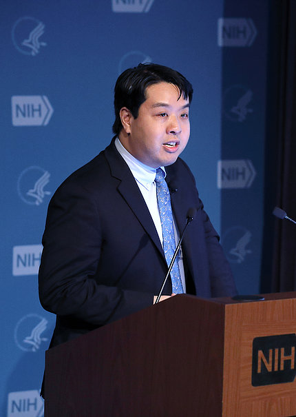 Dr. Chiu stands behind a podium