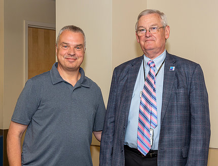 Kaminski meets with Dr. Henderson
