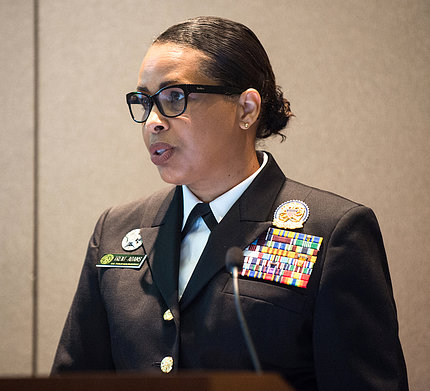Woman in Commissioned Corps uniform speaks at podium.