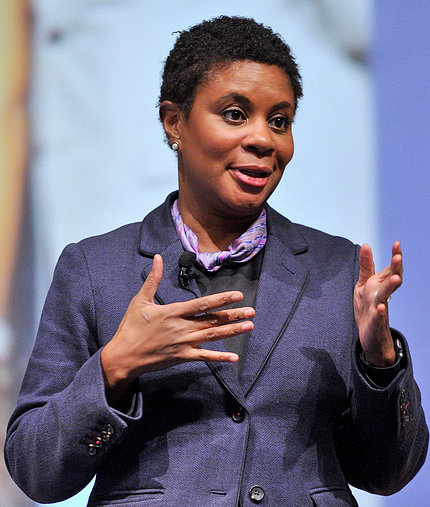 Dr. Alondra Nelson extends her hands