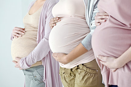 Photo of the bellies of three pregnant women