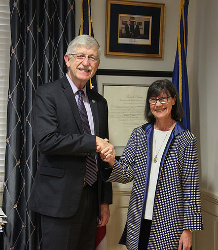NIH director Dr. Francis Collins shakes hands with new NCCIH director Dr. Helen Langevin