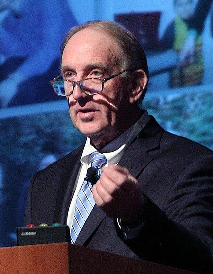 Dr. Philip May at podium