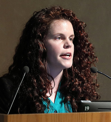 Katherine Randall speaks at the mic