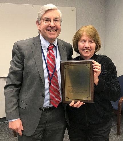 Koroshetz presents Hart with a plaque