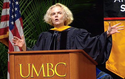 Volkow gestures at podium of UMBC graduation ceremony