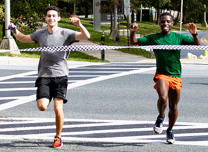 Two runners cross finish line simultaneously
