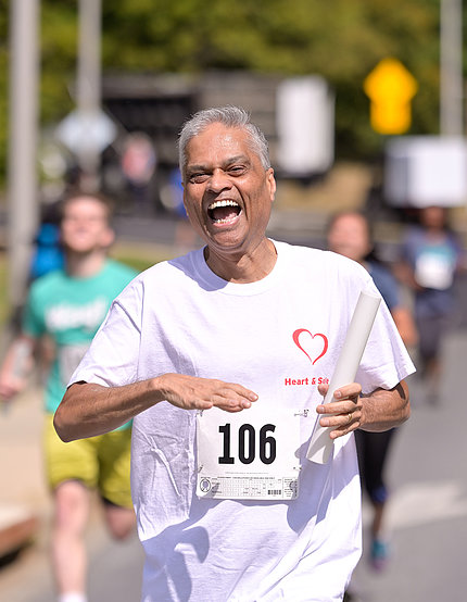 Dr. Danthi runs towards the finish line
