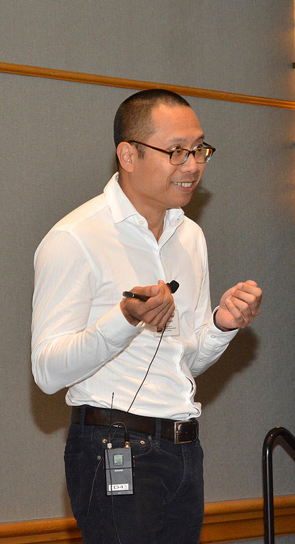 Cell editor Dr. John Pham speaks at meeting.