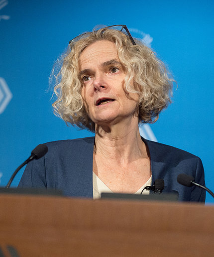 Dr. Volkow at a podium