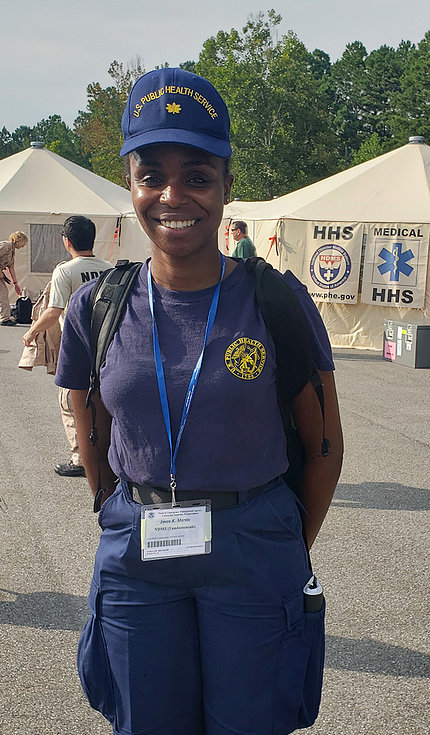 A smiling Dr. Iman Martin out in the field at a FEMA training