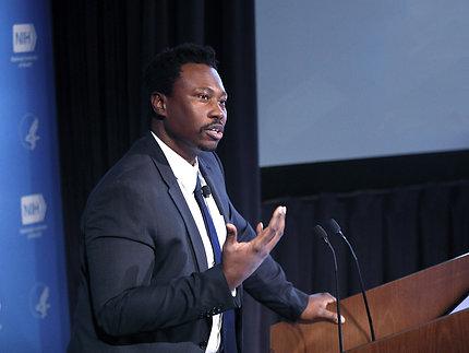 Dr. Jones speaks at podium