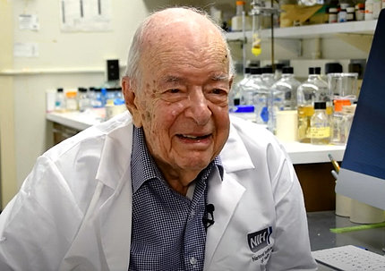 A smiling Dr. Tabor in his lab