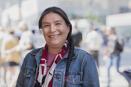 Native American woman smiles into camera