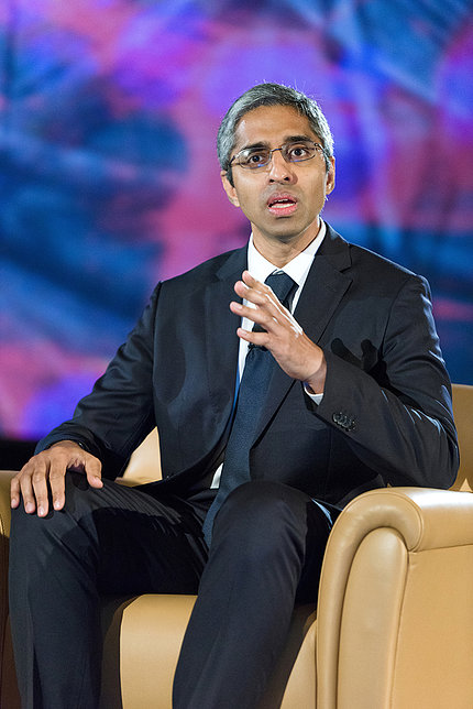 Murthy speaks while sitting in a club chair