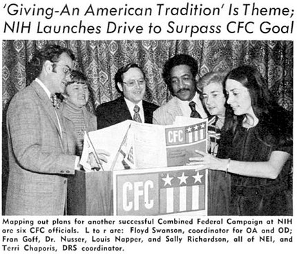 """An NIH Record photo features four employees, including Napper, standing around a podium holding a brochure. Above the photo is a headline that reads, """"'Giving -An American Tradition' is theme; NIH Launches Drive to Surpass CFC Goal."""""""