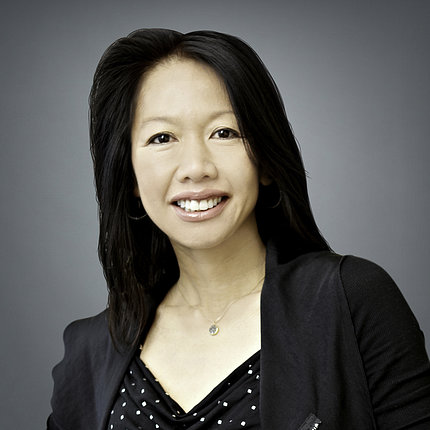 head and shoulders shot of Trinh-Shevrin, smiling
