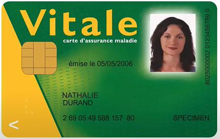 A green and yellow card with a woman's photo, numbers and gold scannable chip