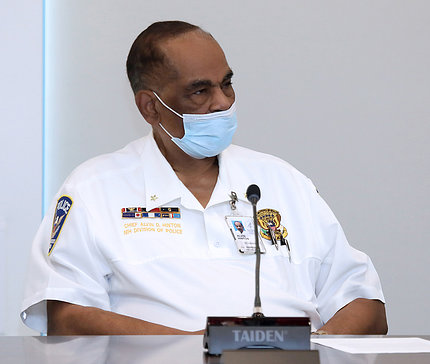 Black male in uniform and facemask