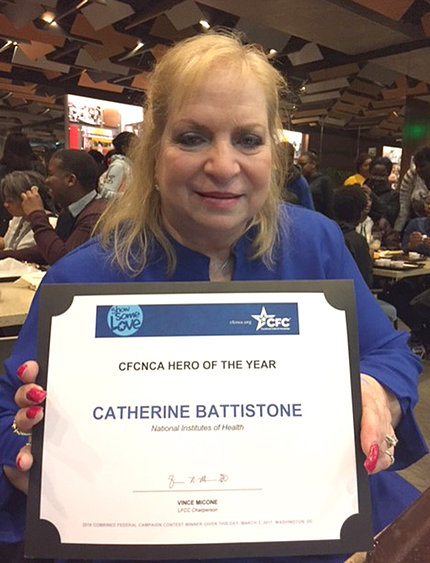 Battistone proudly holds her plaque.